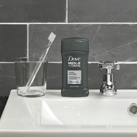 Dove Men+Care Deodorant Stick Extra Fresh 3.0 oz on a sink